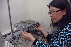 Waste2Watergy co-founder Hong Liu examines her company's microbial fuel cell.